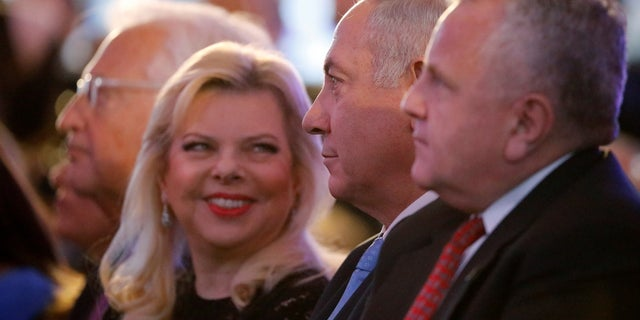 U.S. Deputy Secretary of State John Sullivan, Israeli Prime Minister Benjamin Netanyahu and his wife Sara Netanyahu sit during a reception held at the Israeli Ministry of Foreign Affairs in Jerusalem, ahead of the moving of the U.S. embassy to Jerusalem.