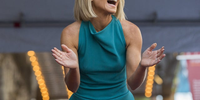 Television personality Kelly Ripa laughs before unveiling her star on the Hollywood Walk of Fame in Los Angeles, California October 12, 2015.  REUTERS/Mario Anzuoni - RTS467V
