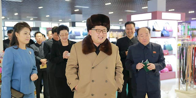 Kim Jong-un accompanied by his wife Ri Sol Ju inspecting the newly built Mirae Shop in Pyongyang on an unknown date.