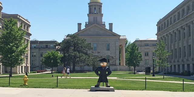 School mascot Herky the Hawk in front of the Old Capitol Museum at the University of Iowa.