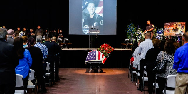 Mourners attend the funeral service for Dallas police officer Patrick Zamarripa, a former U.S. Navy veteran, who was among five police officers shot dead the previous week, in Fort Worth, Texas, U.S. July 16, 2016. REUTERS/Ashley Landis/The Dallas Morning News/Pool - RTSIBU6
