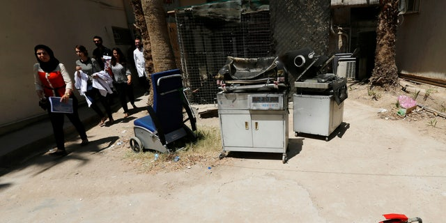Burnt incubators outside a maternity ward after the hospital fire.
