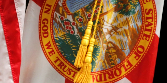 """The Florida state flag displays """"In God We Trust"""" on the seal."""