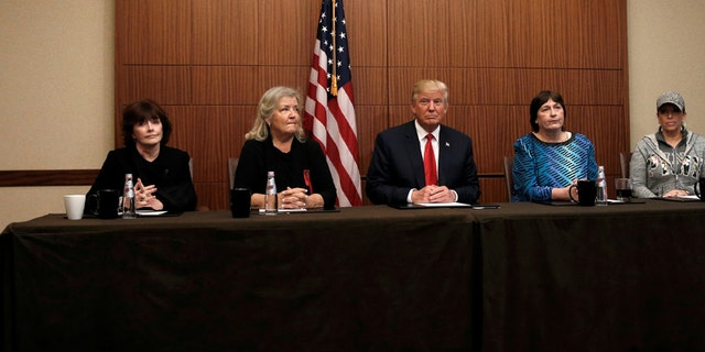 Republican presidential nominee Donald Trump sits with (from R-L) Paula Jones, Kathy Shelton, Juanita Broaddrick and Kathleen Willey in a hotel conference room in St. Louis, Missouri, U.S., shortly before the second presidential debate at Washington University in St. Louis, October 9, 2016. REUTERS/Mike Segar - S1BEUGBLXIAA