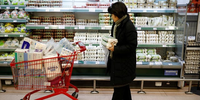 A woman shops for locally produced eggs, during a shortage of eggs as the country culled nearly a fifth of its poultry population amid its worst-ever bird flu outbreak, at a market in Seoul.