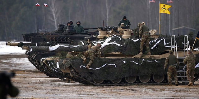 U.S. and Polish soldiers get ready for a firing exercise during the inauguration ceremony of bilateral military training between U.S. and Polish troops in Zagan, Poland, January 30, 2017.