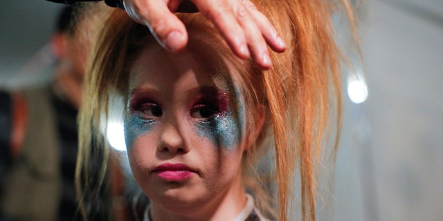 Australian model and designer Madeline Stuart, who has Down syndrome, is prepared backstage before presenting creations from her label 21 Reasons Why By Madeline Stuart during New York Fashion Week in Manhattan, New York, U.S.