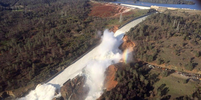 A damaged spillway with eroded hillside is seen in an aerial photo taken over the Oroville Dam in Oroville, California, U.S. February 11, 2017.