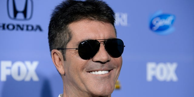 """Judge Simon Cowell attends """"The X Factor"""" season three premiere event in West Hollywood, California September 5, 2013. REUTERS/Phil McCarten (UNITED STATES - Tags: ENTERTAINMENT PROFILE HEADSHOT) - RTX1398M"""