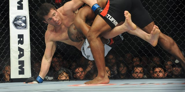 Nov 16, 2013; Las Vegas, NV, USA; Rashad Evans (red gloves) fights against Chael Sonnen (blue gloves) in their light heavyweight bout during UFC 167 at MGM Grand Garden Arena. Mandatory Credit: Stephen R. Sylvanie-USA TODAY Sports - RTX15GPU