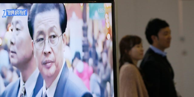 A television showed a report on Jang Song Thaek, North Korean leaders' uncle, at a railway station in Seoul December 3, 2013.