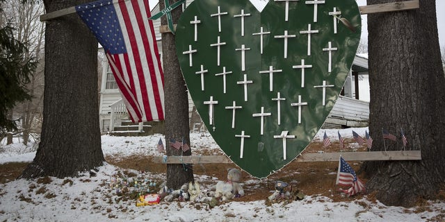 FILE -- A heart is emblazoned with crosses to commemorate the 26 Sandy Hook Elementary School shooting victims in Sandy Hook village in Newtown, Connecticut December 13, 2013.
