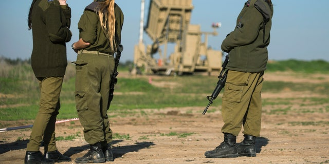 File photo: Israeli soldiers pictured in the city of Ashkelon on January 16, 2014