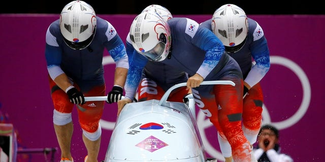 The South Korean bobsled team prepares for a race.