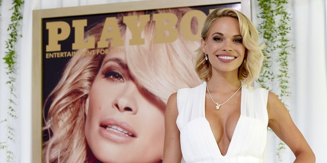 Dani Mathers, 28, the 2015 Playmate of the Year, poses during a luncheon on the garden grounds of the Playboy Mansion in Los Angeles, California May 14, 2015. Mathers, the 56th Playmate of the Year, also receives $100,000 in prize money and a one-year lease on a 2015 Mini Cooper S Convertible in Midnight Black. REUTERS/Kevork Djansezian - RTX1D0UO