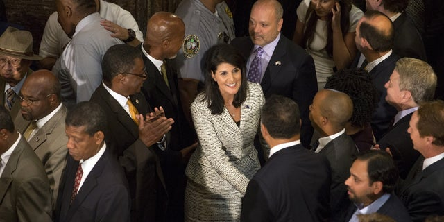 South Carolina Gov. Nikki Haley is greeted at the state house before she signed legislation removing the Confederate battle flag from the state Capitol grounds.