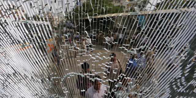 The days of broken windows might just be over, thanks to a team of researchers that have developed glass they say is as strong a steel. ( REUTERS/Amit Dave)