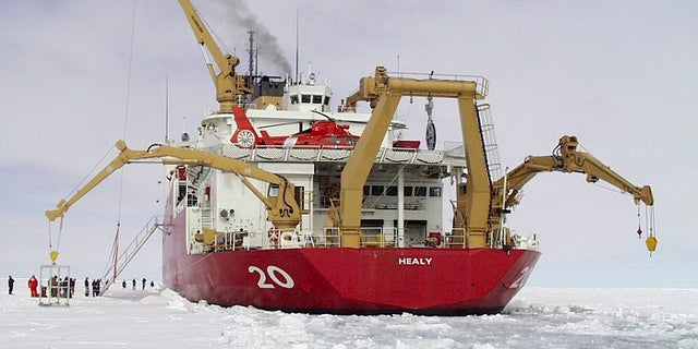 U.S. Coast Guard Polar Icebreaker/Research Vessel Healy, (WAGB 20) named after Captain Michael A. Healy, most notable as the foremost seaman and navigator of his time in the Bering Sea and Alaskan Arctic regions while Commanding Officer of the U. S. Revenue Cutter BEAR from 1886 to 1895, is pictured breaking ice in this November 30, 1999 photo. President Barack Obama on September 1, 2015 proposed a faster timetable for buying a new heavy icebreaker for the U.S. Arctic, where quickly melting sea ice has spurred more maritime traffic, and the United States has fallen far behind Russian resources.  REUTERS/U.S. Coast Guard/Handout   FOR EDITORIAL USE ONLY. NOT FOR SALE FOR MARKETING OR ADVERTISING CAMPAIGNS. THIS IMAGE HAS BEEN SUPPLIED BY A THIRD PARTY. IT IS DISTRIBUTED, EXACTLY AS RECEIVED BY REUTERS, AS A SERVICE TO CLIENTS - RTX1QN8N