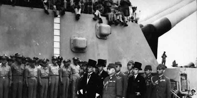 Japan's delegation gather to sign the formal surrender document on the U.S. Navy battleship USS Missouri in Tokyo Bay in a September 2, 1945 file photo.