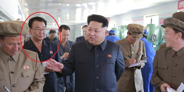 Ri Man-gon (circled) is pictured with Kim Jong Un in September 2015 at Sinuiji Measuring Instrument Factory.