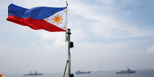 A Philippine flag flutters on the Strategic Sealift Vessel BRP Tarlac LD601 during the commissioning ceremony of the newly acquired BRP Tarlac and three Landing Craft Heavies (LCHs) at the celebration of Philippine Navy's 118th anniversary in Manila, Philippines June 1, 2016.