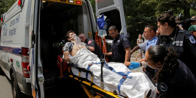 A man is loaded into an ambulance after he was injured in an explosion in Central Park.
