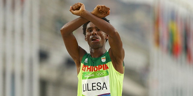 Marathoner Feyisa Lilesa of Ethiopia has been exiled after he crossed his arms over his head at the finish line in protest of his country's treatment of his ethnic group at the 2016 Rio Games.