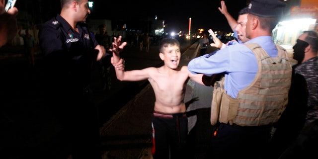 Iraqi security forces detaining the boy in Kirkuk.