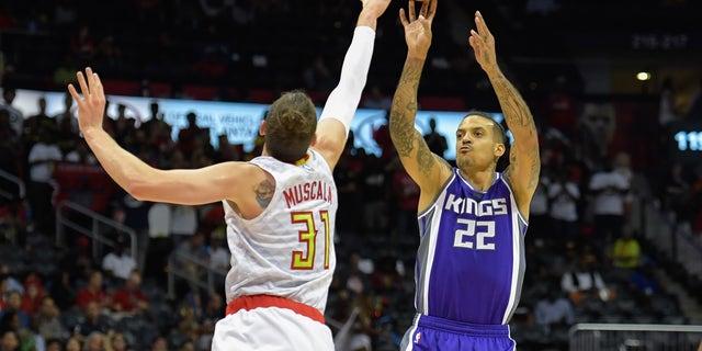 Sacramento Kings forward Matt Barnes (22) shoots over Atlanta Hawks forward Mike Muscala (31) during a game in October.