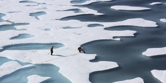 The crew of the  U.S. Coast Guard Cutter Healy, in the midst of their ICESCAPE mission, retrieves supplies in the Arctic Ocean in this July 12, 2011 NASA handout photo.  Kathryn Hansen/NASA via REUTERS/File Photo       ATTENTION EDITORS - THIS IMAGE WAS PROVIDED BY A THIRD PARTY. EDITORIAL USE ONLY.  - RTX2RRXI