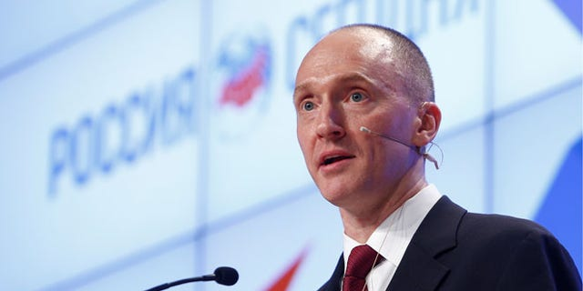 One-time advisor to President Trump Carter Page addresses the audience during a presentation in Moscow, Russia, December 12, 2016. REUTERS/Sergei Karpukhin - RC165B503FF0