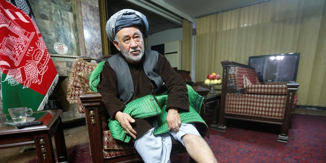 Ahmad Eshchi shows an injury on his leg during an interview at his home in Kabul.