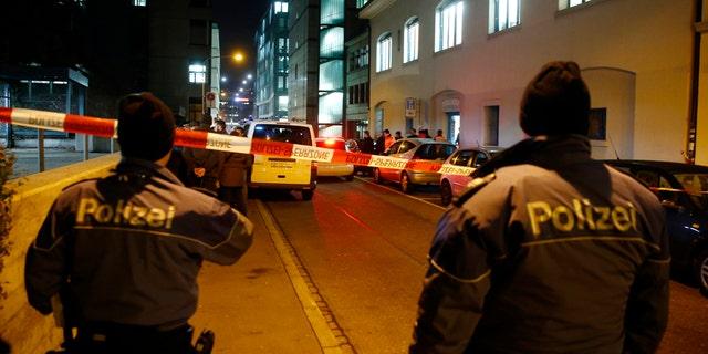 Police stand outside an Islamic center in central Zurich, Switzerland December 19, 2016. REUTERS/Arnd Wiegmann  - RTX2VPK4