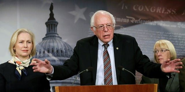 Senator Bernie Sanders (I-VT) speaks between Senators Kirsten Gillibrand (D-NY) (L) and Patty Murray (D-WA) during a news conference to unveil the FAMILY Act on Capitol Hill in Washington, U.S., March 14, 2017. REUTERS/Yuri Gripas - RTX30ZMO