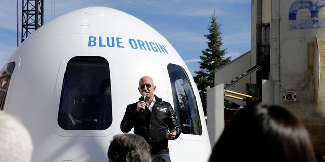 FILE -- Amazon and Blue Origin founder Jeff Bezos addresses the media about the New Shepard rocket booster and Crew Capsule mockup at the 33rd Space Symposium in Colorado Springs, Colorado, April 5, 2017.
