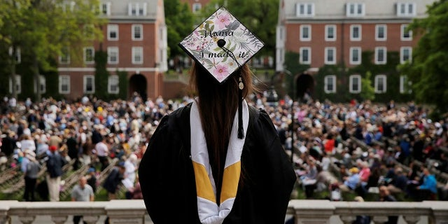 """Senior Kayla Ray Madison has """"Mama I Made It"""" written on her cap as she waits to graduate during Commencement at Smith College in Northampton, Massachusetts, U.S., May 21, 2017.   REUTERS/Brian Snyder - RTX36W1W"""