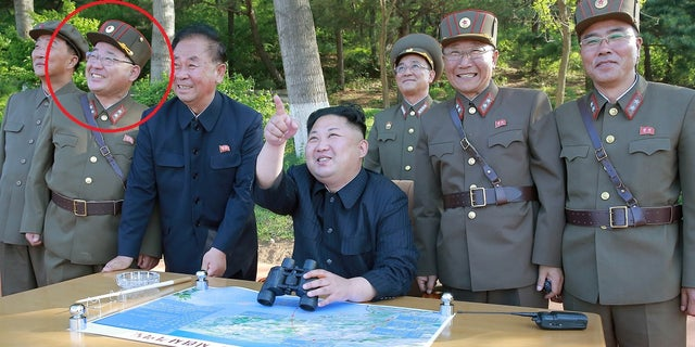 Kim Jong Sik is circled in red in this photo. He is the scientist behind many of the country's missile successes.