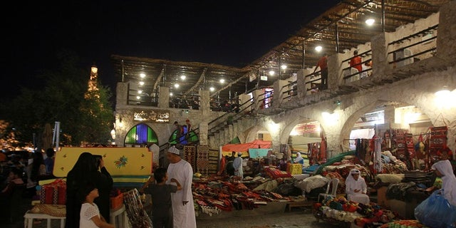 People walk at Souq Waqif market in Doha, Qatar, June 9, 2017. REUTERS/Naseem Zeitoon - RTX39WLL