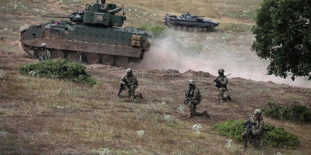"""U.S. army soldiers take part in """"Peace Sentinel 2017,"""" a joint military drill together with Serbian and Bulgarian soldiers at Koren military training ground, Bulgaria, July 15, 2017."""