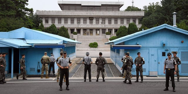 South Korea and U.S. soldiers stand guard during a commemorative ceremony for the 64th anniversary of the Korean armistice at the truce village of Panmunjom in the Demilitarized Zone (DMZ) dividing the two Koreas.