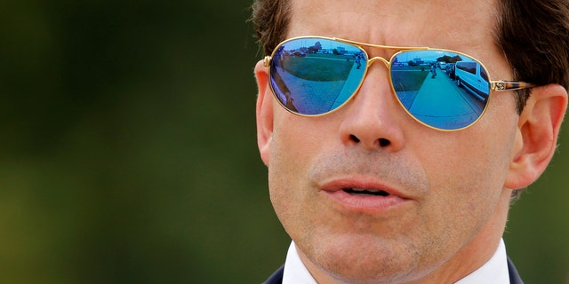 White House Communications Director Anthony Scaramucci accompanies U.S. President Donald Trump for an event about his proposed U.S. government effort against the street gang Mara Salvatrucha, or MS-13, with a gathering of federal, state and local law enforcement officials in Brentwood, New York, U.S. July 28, 2017. REUTERS/Jonathan Ernst - RTX3DC5F