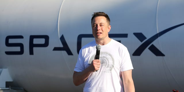 FILE -- Elon Musk, founder, CEO and lead designer at SpaceX and co-founder of Tesla, speaks at the SpaceX Hyperloop Pod Competition II in Hawthorne, California, August 27, 2017.