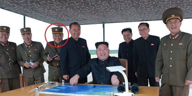 Kim Jong Sik, indicated in picture, stands behind North Korean leader Kim Jong Un, who is inspecting a long and medium-range ballistic rocket.