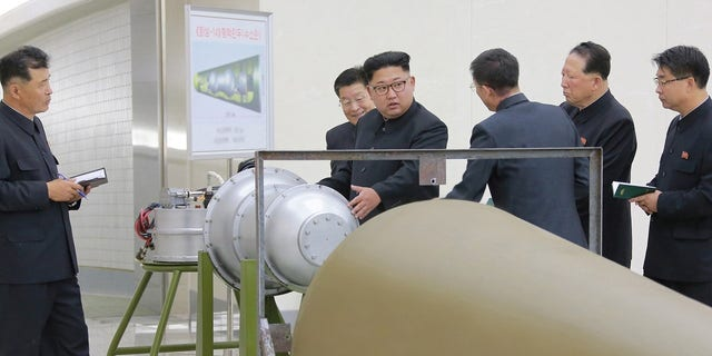 Kim Jong Un inspects what North Korea claims to be a nuclear warhead. The photos were released the same day North Korea conducted its sixth nuclear test in September.