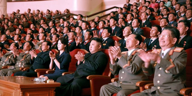 North Korean leader Kim Jong Un claps during a celebration for nuclear scientists and engineers who contributed to a hydrogen bomb test, in this undated photo released by North Korea's Korean Central News Agency (KCNA) in Pyongyang.