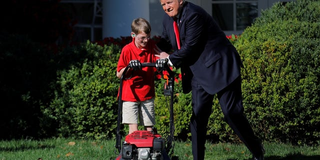 President Trump welcomes 11-year-old Frank Giaccio as he cuts the Rose Garden grass.