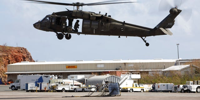 Pictured here, a UH-60 Black Hawk helicopter delivers disaster relief supplies in Saint Thomas in the U.S. Virgin Islands. Five soldiers went missing after one of these helicopters crashed off the coast of Hawaii in August 2017.
