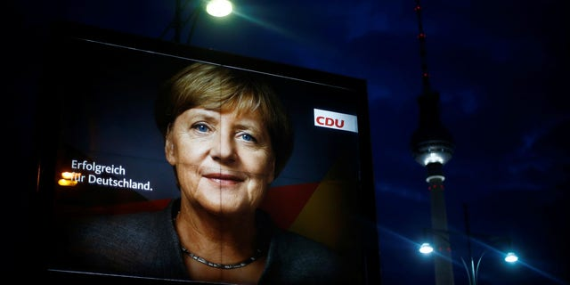 An election campaign poster for the upcoming general elections of the Christian Democratic Union party (CDU) with a headshot of German Chancellor Angela Merkel is displayed at Alexanderplatz square in Berlin, Germany, September 21, 2017.