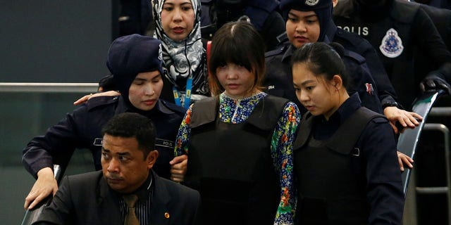Doan Thi Huong visits the airport where Kim Jong Nam was murdered. The women were reportedly emotional during the trip.