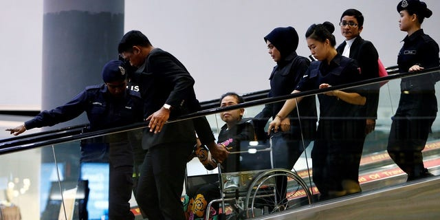 Siti Aisyah was placed in a wheelchair after complaining of exhaustion.